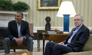 In this Oct. 12, 2013, file photo President Barack Obama, Senate Majority Leader Harry Reid of Nev., right, and other Democrat Senators meet in the Oval Office of the White House.