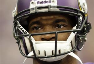 Minnesota Vikings running back Adrian Peterson pauses during introductions before an NFL football game against the Carolina Panthers in Minneapolis, Sunday, Oct. 13, 2013.