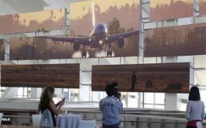 People take photographs at the new Tom Bradley International Terminal Thursday, June 20, 2013 at the Los Angeles International Airport. Monday's three bombs were found in the new terminal.