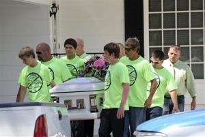Pallbearers wearing anti-bullying T-shirts carry the casket of Rebecca Sedwick,12, to a waiting hearse as they exit a funeral home Monday, Sept. 16, 2013, in Bartow, Fla.