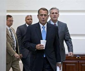 Speaker of the House John Boehner with House Majority Whip Kevin McCarthy walks to a meeting of House Republicans at the Capitol, Oct. 15, 2013.