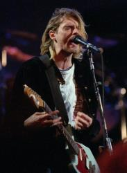 In this Dec. 13, 1993 file photo, Kurt Cobain, lead singer for the Seattle-based band Nirvana, performs during the taping of MTV's Live and Loud Production in Seattle.
