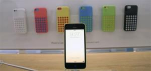 A row of iPhone 5c phones are on display at the Apple Store on Lincoln Road in Miami Beach, Fla., Friday, Sept. 20, 2013, the first day of sales for the phone.
