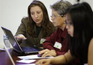 Maia Weinstock, left, a Brown University graduate, works with Anne Fausto-Sterling, a professor of biology, during a Wikipedia edit-a-thon, on the Brown campus in Providence, R.I.