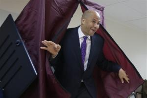 Newark Mayor Cory Booker walks out of a polling booth after casting his vote in a special election for the vacant New Jersey seat in the U.S. Senate, Wednesday, Oct. 16, 2013, in Newark, NJ.