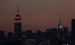 Part of the New York skyline is seen at sunset.