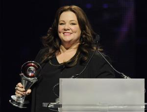 Actress Melissa McCarthy smiles after winning the Female Star of the Year award at the CinemaCon 2013 Big Screen Achievement Awards at Caesars Palace on Thursday, April 18, 2013 in Las Vegas.