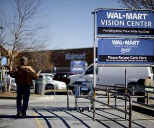A man walks through the parking lot of the Walmart Monday, Nov. 26, 2012, in Lithonia, Ga.