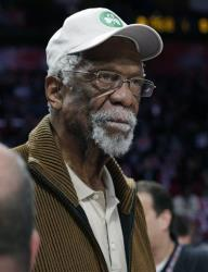 Former Boston Celtis' Bill Russell watches the NBA All-Star Saturday Night basketball competition in this Feb. 16, 2013 file photo in Houston.