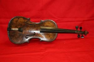 This undated handout image from auction house Henry Aldridge and Son shows a  violin believed to be the one played by Titanic bandmaster Wallace Hartley.