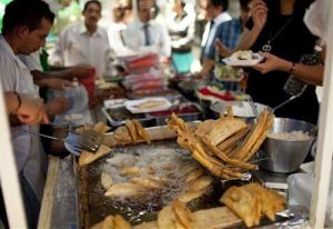 Office workers eat tacos at an outdoor food stand during lunch time in Mexico City.