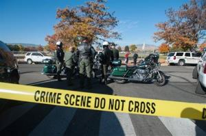 Police secure the scene near Sparks Middle School after a shooting in Sparks, Nev., on Monday, Oct. 21, 2013.