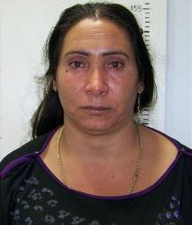Greek Roma woman Eleftheria Dimopoulou, 40, or Selini Sali—she has two separate sets of identity papers—is seen in the Larisa regional police headquarters, Greece.