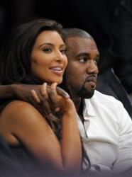 Kim Kardashian and Kanye West watch the Los Angeles Lakers play the Denver Nuggets in Game 7 in their first-round NBA basketball playoff series, Saturday, May 12, 2012, in Los Angeles.
