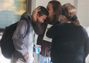 A  Sparks Middle School student cries after being released from Agnes Risley Elementary School, where some students were evacuated to after the shooting, on Monday, October 21, 2013 in Sparks, Nev.