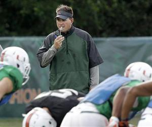 Miami head coach Al Golden, rear, watches a drill during team practice, Tuesday, Oct. 22, 2013, in Coral Gables, Fla.