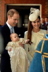 Britain's Prince William, Kate Duchess of Cambridge with their son Prince George arrive at Chapel Royal in St James's Palace in London, for the christening of the three month-old Prince George, Wednesday Oct. 23, 2013.