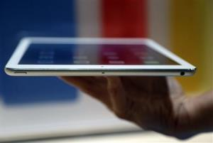 An Apple employee holds up the new iPad Air on Tuesday.