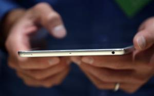 An Apple employee demonstrates the new iPad Mini on Tuesday, Oct. 22, 2013, in San Francisco.