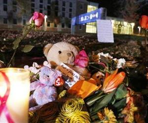 Candles and teddy bears are placed at Danvers High School prior to a candlelight vigil to mourn the death of Colleen Ritzer, a 24-year-old math teacher at Danvers High School, Oct 23, 2013.