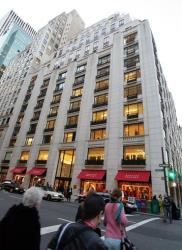 Pedestrians pass near the 'Barneys New York'  store on Madison avenue in this Nov. 11, 2004.