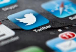 In this Feb. 2, 2013, file photo, a smartphone display shows the Twitter logo in Berlin, Germany.