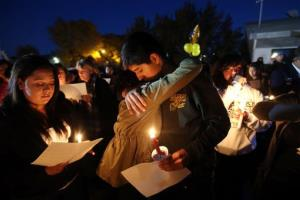 Hundreds of students and residents attend a candlelight vigil at Sparks Middle School in Sparks, Nev., on Wednesday, Oct. 23, 2013.