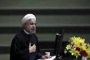 In this Aug. 15, 2013 file photo, Iranian President Hasan Rouhani speaks at parliament in Tehran.