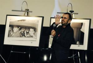 Ringo Starr talks in front of a photograph he took of five teens, unveiled in his new book.