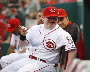In this Aug. 17, 2012, photo, Cincinnati Reds guest bat boy Ted Kremer smiles in the dugout.