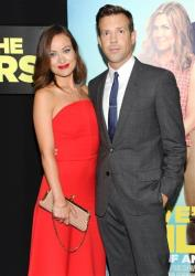 Actor Jason Sudeikis, right, and his fiancee Olivia Wilde attend the world premiere of We're The Millers at the Ziegfeld Theatre on Thursday, Aug. 1, 2013 in New York.