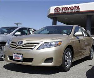 In this Aug. 30, 2011 file photo, 2012 Toyota Camrys are parked at a car dealership in San Jose, Calif.
