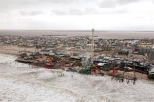 This Oct. 30, 2012, photo provided by the US Air Force shows an aerial view of the roller coaster from the Seaside Heights amusement park on the New Jersey shore submerged in surf during Sandy.