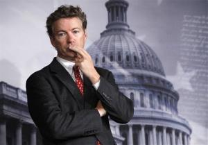 This Oct. 13, 2011 file photo shows Sen. Rand Paul, R-Ky. listening to a question during a news conference on Capitol Hill in Washington.