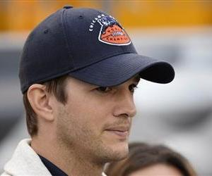 Ashton Kutcher walks along the sideline before the NFL football game between the Pittsburgh Steelers and the Chicago Bears at Heinz Field on Sunday, Sept. 22, 2013, in Pittsburgh.