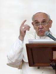 Pope Francis speaks during the Marian prayer in St. Peter's square at the Vatican, Saturday, Oct. 12, 2013.