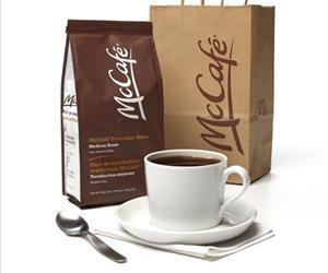 This promotional image shows bags of the ground coffee McDonald's will start selling at its restaurants in Canada next month, a move that could spread to other regions around the world if successful.