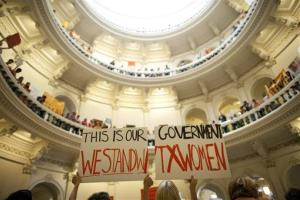 In this July 12, 2013 file photo, abortion rights supporters rally on the floor of the State Capitol rotunda in Austin, Texas.