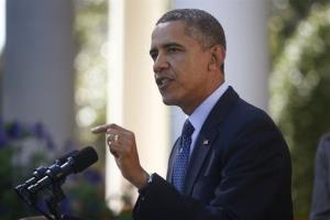 In this Oct. 21, 2013 file photo, President Obama speaks during an event in the Rose Garden of the White House on the initial rollout of the health care overhaul.