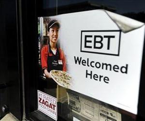 In this Aug. 26, 2011 photo, a sign notifies customers that EBT can be used at a store in Sioux Falls, SD.
