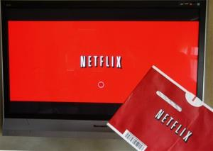 A Netflix DVD envelope and Netflix on-screen television menu are shown in Surfside, Fla.