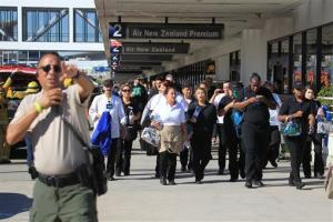 Passengers are directed outside Terminal 2 at Los Angeles International Airport on Friday.