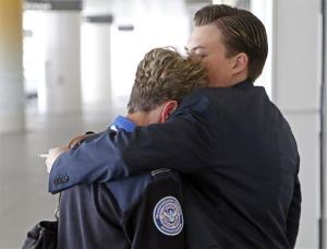 Transportation Security Administration employees hug at LAX after today's shooting.