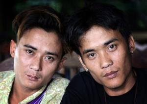 In this Sept. 26, 2013 photo, Johnny, left, and his twin brother Luther Htoo pose for photos after their reunion at a restaurant in Sangkhlaburi district of Kanchanaburi province, western Thailand.