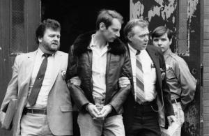 In this Jan. 16, 1985, photo, Bernhard Goetz is escorted by police as he is taken out of criminal court in New York.