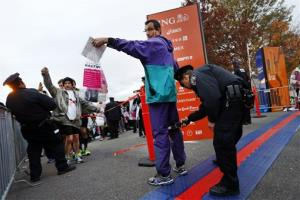 Runners are screened by police officers as they arrive for the New York City Marathon, Sunday, Nov. 3, 2013, in New York.