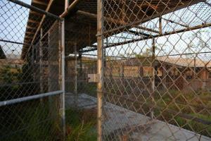 This June 20, 2013 file photo shows a view inside of open air pen used to confine detainees at Camp X-Ray, Naval Station Guantanamo Bay, Cuba.