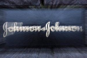 In this Thursday Nov. 15, 2007 file photograph, the logo is seen on a wall outside the health care products maker Johnson & Johnson's world headquarters in New Brunswick, NJ.