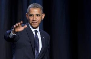 President Barack Obama waves after speaking at the SelectUSA Investment Summit, Thursday, Oct. 31, 2013 in Washington. Obama encouraged international businesses and investors to bring new investment and jobs to the United States.