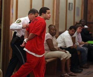 Eric Rivera Jr. is moved through the hallway to the courtroom holding room, Nov. 1, 2013, during the third day of deliberations in the Sean Taylor murder trial in Miami.